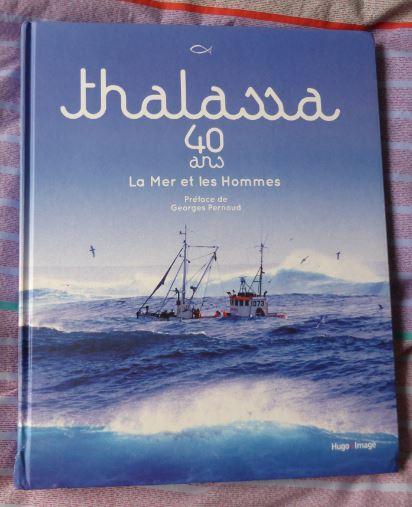 Livre thalassa avec coin abime